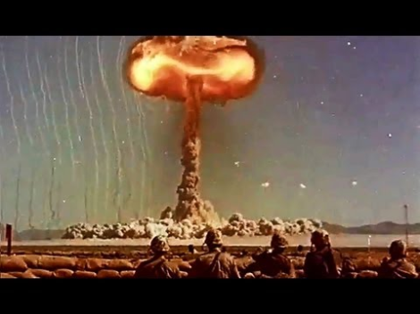 US Army Soldiers Observe Atomic Bomb Blasts in the 1950s. From public domain film from the US Army via the Prelinger Archive.