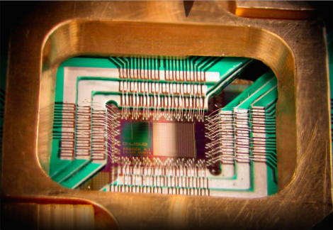 This is a 128-qubit chip from a quantum computer produced by D-Wave. Image credit: https://upload.wikimedia.org/wikipedia/commons/1/17/DWave_128chip.jpg