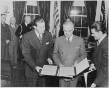 745px-Photograph_of_President_Truman_receiving_a_set_of_stamps_honoring_the_late_President_Franklin_D._Roosevelt_from..._-_NARA_-_199345