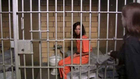 Female_prisoner_shackled_in_her_small_cell